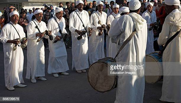Traditional musicians in white robes Essaouira Morocco north Africa