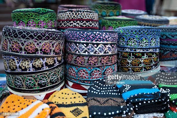 Traditional muslim prayer caps takiyah or kufi on sale at Meena Bazar market in Muslim area of Old Delhi India