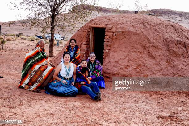 Traditional Native American Family Posing outside an authentic Navajo Hogan