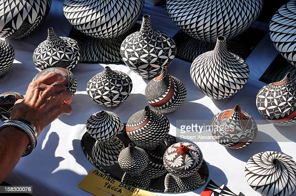 Traditional Native American pottery by Acoma Pueblo artist Sandra Victorino for sale at the 2012 Indian Market presented each August by the...
