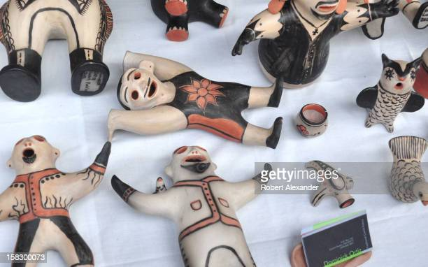 Traditional Native American 'storyteller' pottery by Cochiti Pueblo artist Dominick Ortiz for sale at the 2012 Indian Market presented each August by...