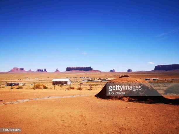traditional navajo home, known as a hogan, monument valley, arizona, usa - monument valley tribal park stock photos and pictures