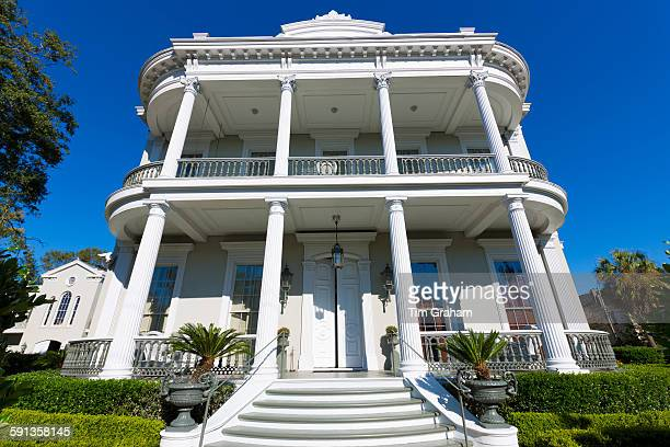 Traditional neoclassical grand mansion house with double gallery and columns in the Garden District of New Orleans USA