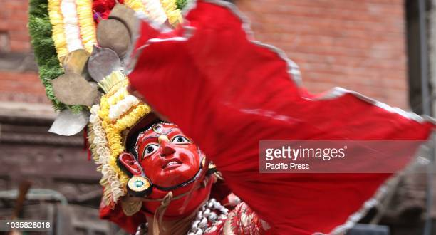 A traditional Nepalese masked dancer performs Devi dance prior of Indrajatra festival in KathmanduNepal People worship Indraking of gods during the...