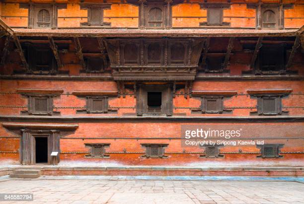 traditional nepali wood carving style around windows and gate at kathmandu dubar square, nepal. - copyright by siripong kaewla iad ストックフォトと画像