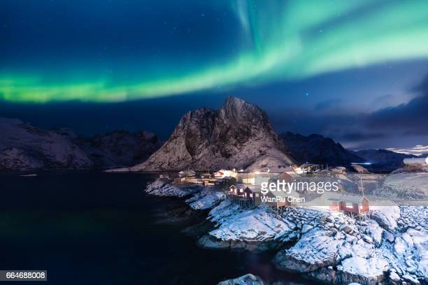 Traditional Norwegian fishing cottages with aurora