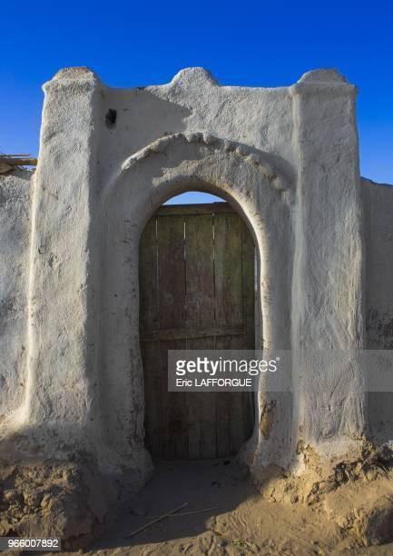 Traditional nubian architecture and plasterwork of a fine doorway tumbus Sudan on March 21 2013 in Tumbus Sudan