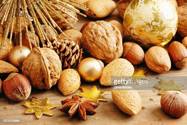 traditional nuts baubles christmas background - 2000 2009 stock pictures, royalty-free photos & images