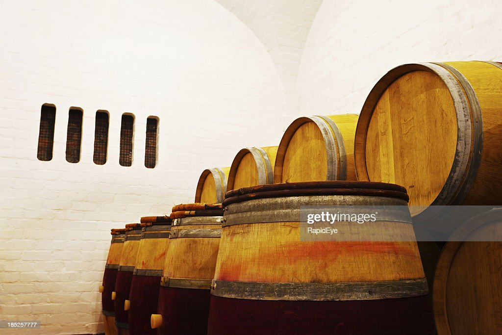 oak wine barrels. Traditional Oak Wine Barrels In A Modern Winery : Stock Photo O