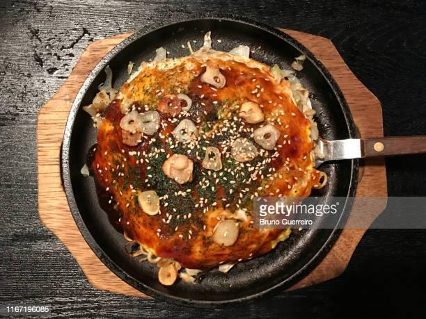 traditional okonomiyaki japanese dish - okonomiyaki stock pictures, royalty-free photos & images