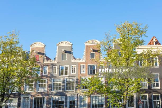 Traditional old building facades at the canals in Amsterdam, the Netherlands