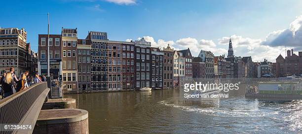 "traditional old buildings at a canal in amsterdam, the netherlands - ""sjoerd van der wal"" stock pictures, royalty-free photos & images"