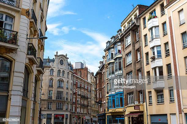 Traditional old buildings by street at lille france