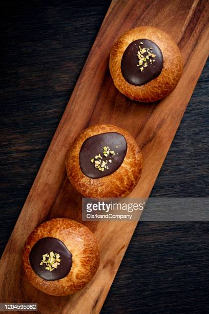 traditional old fashioned fastelavnboller or danish cream cakes - danish culture stock pictures, royalty-free photos & images
