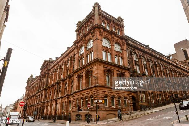 traditional old gothic building at street of glasgow scotland england - old glasgow stock photos and pictures