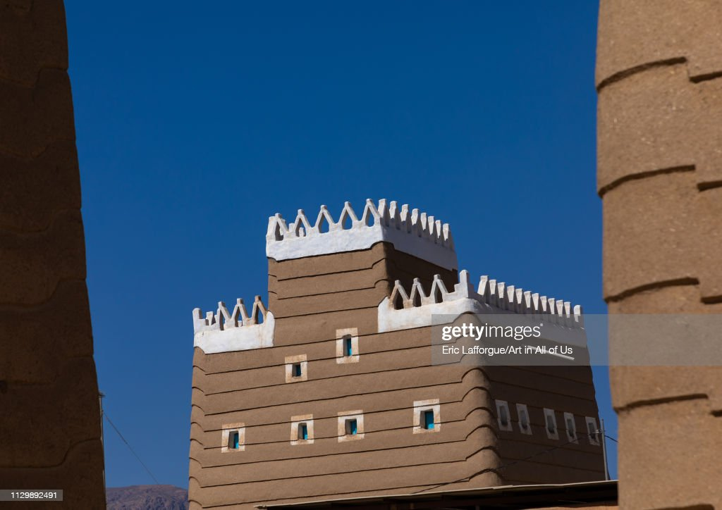 Traditional old mud house against blue sky, Najran Province, Najran