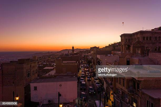 traditional old stone buildings during sunset at mardin turkey