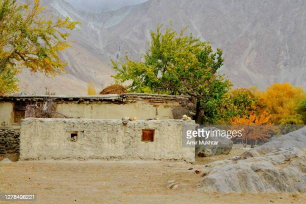 traditional old style house made with stones and mud in autumn season. - skardu stock pictures, royalty-free photos & images