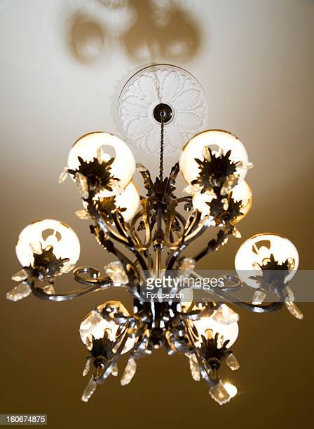 traditional ornate chandelier - crown molding stock photos and pictures