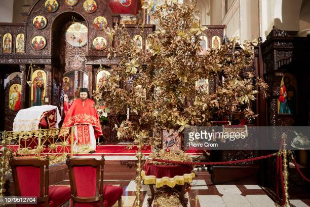 A traditional Orthodox Christian Christmas tree is seen as Patriarch Irinej head of the Orthodox Christian church in Serbia gives a mass in the...
