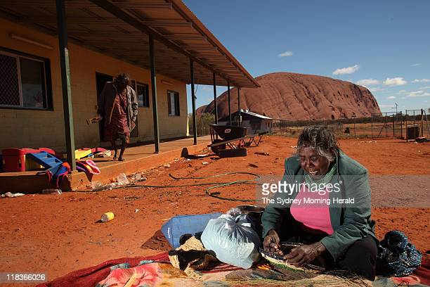 Traditional Owner Judy Trigger weaves baskets for the tourist trade in her friend's front yard in Mutitjulu near Uluru in the Northern Territory 22...