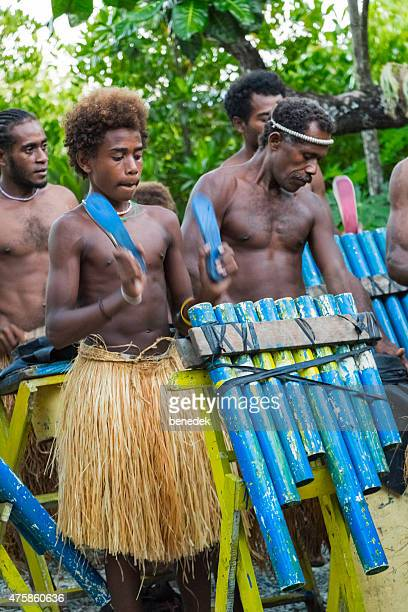 traditional pan pipe band performing on solomon islands tribal culture - solomon islands stock pictures, royalty-free photos & images