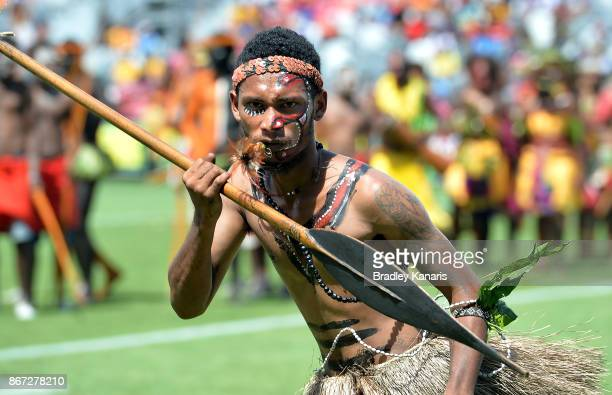 Traditional Papua New Guinean dancers perform before the Rugby League World Cup match between Papua New Guinea and Wales at Oil Search National...