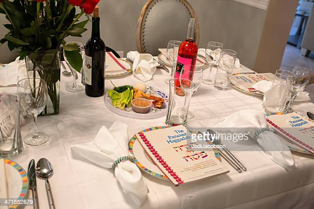 traditional passover seder table with haggadah - passover seder stock pictures, royalty-free photos & images
