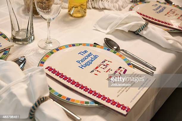 traditional passover seder table with haggadah - happy passover stock pictures, royalty-free photos & images