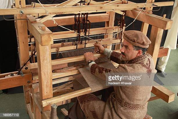 Traditional Pati weaver at Hunza, Gilgit Baltistan - Pakistan. Pati's raw material is hand spined wool ehich is collected by sheeps and goat's...