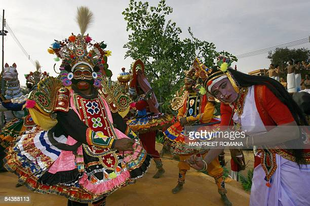 Traditional performers from Tamil Nadu state pose for a picture during a press preview of tableaux participating in the forthcoming Republic Day...