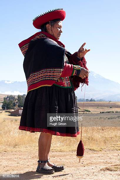 traditional peruvian woman making wool thread. chinchero. peru. - hugh sitton stock pictures, royalty-free photos & images