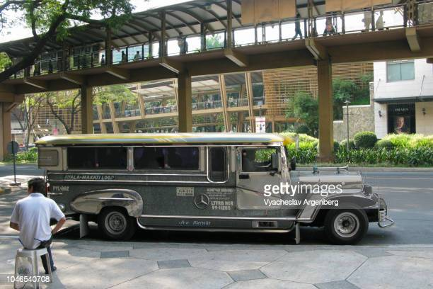 traditional philippine jeepney in manila, icon of philippine culture - argenberg stock pictures, royalty-free photos & images