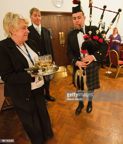 A traditional pier prepares to pipe in the haggis during a Burns night organised by The Ceilidh Club at Hammersmith City Hall on January 23 2010 in...