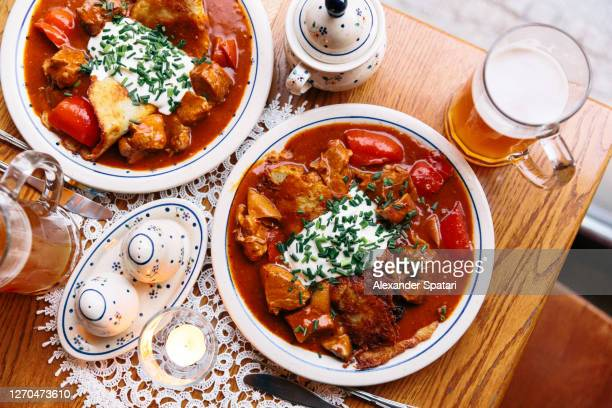 traditional polish food - potato pancake with beef goulash - traditionally hungarian stock pictures, royalty-free photos & images