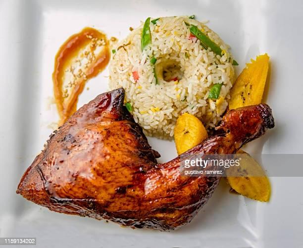 traditional pollo al cilindro peruvian food - cultura peruana fotografías e imágenes de stock