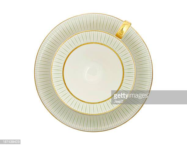 Traditional porcelain tea cup top view, gold and green pattern
