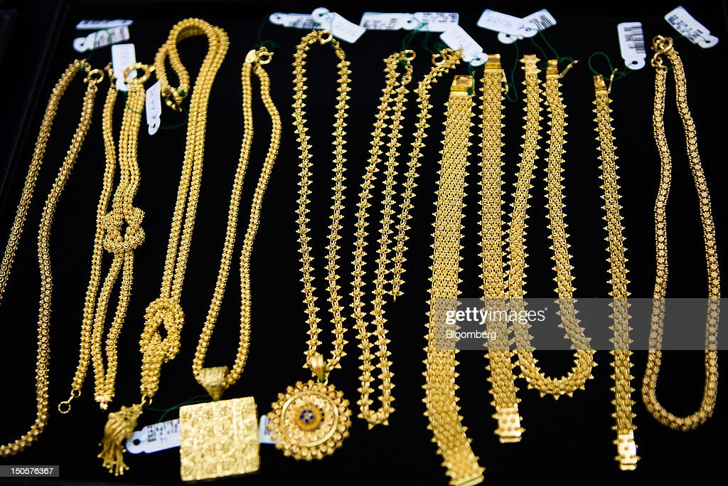 Traditional Portuguese gold jewelry sits on display in the window of a jewelry store in Lisbon, Portugal, on Wednesday, Aug. 22, 2012. In Portugal, the historical home of some of Europe's biggest gold reserves, the number of jewelry stores, which include cash-for-gold shops, increased 29 percent in 2011 from a year earlier, a study commissioned by parliament found. Photographer: Mario Proenca/Bloomberg via Getty Images