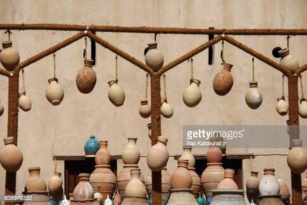 traditional pottery in a souk market in nizwa, oman - gulf of oman photos et images de collection