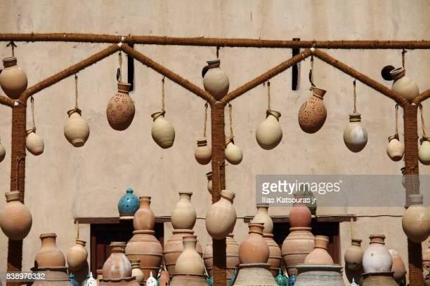 Traditional pottery in a souk market in Nizwa, Oman
