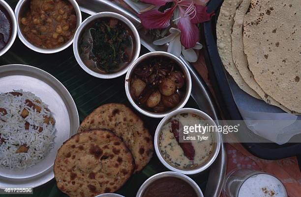 RANTHAMBHORE RAJASTHAN INDIA A traditional Rajasthani meal thali dishes made from vegetables and legumes rice with nuts lassi drink and chapatti at...