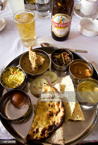 Traditional Rajasthani thali meal served with  cold Kingfisher beer.