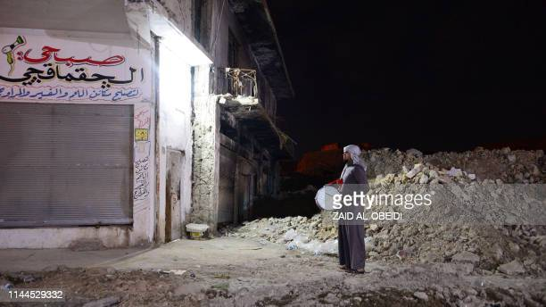 Traditional Ramadan drummer beats his drum in the streets of the old city of Mosul in northern Iraq, as he makes calls for Muslims to wake up for...