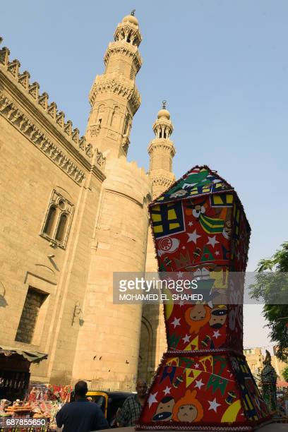 A traditional Ramadan lantern decorates the street near the Sayeda alZeinab mosque in Cairo on May 24 ahead of the start of the Muslim holy fasting...