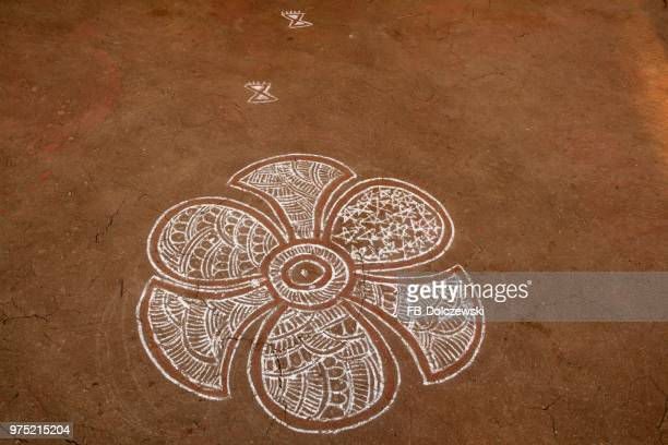 Traditional Rangoli, Kolam or Muggu, decorative pattern of colored sand on the ground, Jaisalmer, Rajasthan, India