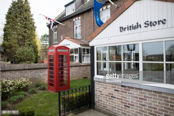 A traditional red British telephone box stands outside the Stonemanor British Store and Tea Rooms in Kortenberg Belgium on Friday March 31 2017 UK...