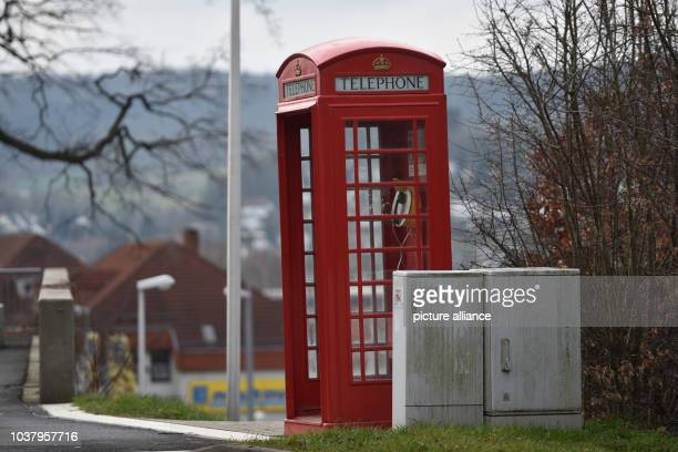 A traditional red English phone box in a street outside the railway station in Melsungen Germany 18 February 2016 PHOTO UWE ZUCCHI/DPA | usage...