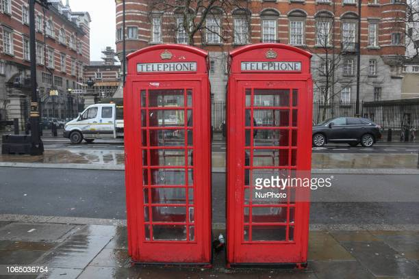 Traditional red telephone booth in London The red or black sometimes phone cabins are part of the historical architecture in London