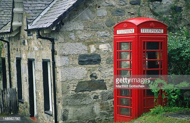 A traditional red telephone box in the Grampian Mountains - Highland, Scotland