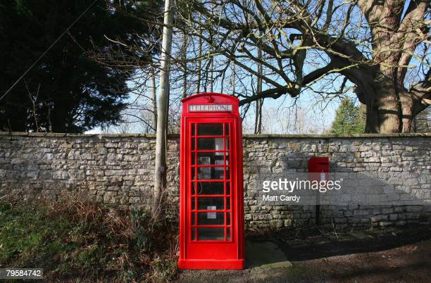 A traditional red telephone box stands empty in the village of Priston on February 6 2008 near Bath Somerset England According to BT payphone use in...